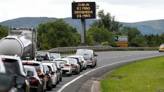 Vehicles queue on the approach to the border between the Irish Republic and Northern Ireland