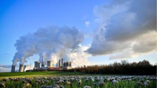 """Steam rises from the brown coal-fired power plant Neurath (front-C) and Niederaussem (rear-L) operated by RWE in Bergheim, 04 December 2018. The Rhenish Brown Coal Field is Europe""""s largest carbon dioxide source. According to a report by the UN, the carbon dioxide (CO2) emissions have gone up for the first time in four years. The report came just days ahead of the COP24 United Nations Climate Change Conference taking place in Poland from 02 to 14 December 2018. EPA/SASCHA STEINBACH"""