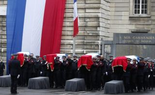 "French Police officers carry coffins during a ceremony to pay tribute to the victims of the 03 October knife attack in Paris"" Police headquarters, in Paris, France, 08 October 2019"