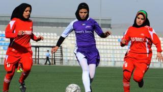 Women playing football in hijab in Kabul in 2013.