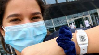 A woman wearing a tracking wristband