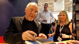 Paulo Coelho signing novels at an event in 2007