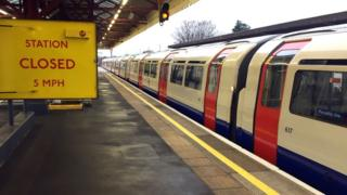 An empty Piccadilly line train at Stamford Brook underground station