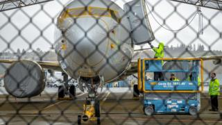 Workers inspect a Boeing 737 MAX aircraft owned by American Airlines