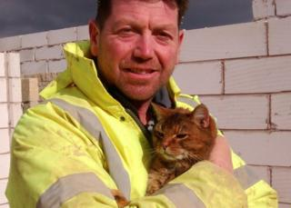 Builder with cat