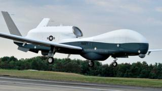 A US Navy MQ-4C Triton unmanned aircraft system prepares to land at Naval Air Station Patuxent River, Md., Sept. 18, 2014, after completing a cross-country flight from California. The Triton will conduct flight testing at Patuxent River in preparation for an operational deployment in 2017. (US Navy photo by Kelly Schindler