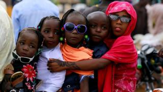 in_pictures Children are seen on a motorbike after Muslims in Nigeria perform Eid prayer following the global outbreak of coronavirus disease (COVID-19) in Nasarawa May 24, 2020.