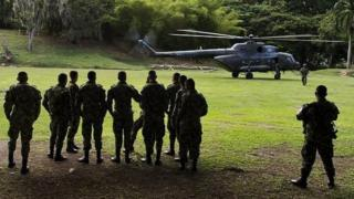 A Russian-made MI-17 helicopter of the Colombia's army prepares to take off from a military base in Buga, Colombia on September 26, 2014.