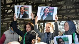 Women hold pictures of film maker Naji Jerf, who was killed on December 27, during his funeral in Gaziantep (28 December 2015)