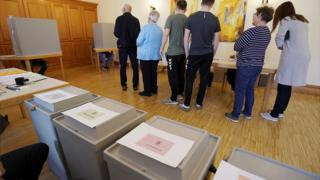 Voters stand at the European elections in a polling station in Gamshurst near Achern, Germany, 26 May 2019