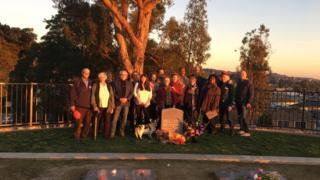 Survivors gather at Evergreen Cemetery in Oakland