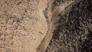 Competitors take part in Stage 3 of the 33rd edition of the Marathon des Sables between Rich Mbirika and Nord El Maharch in the southern Moroccan Sahara desert on April 10, 2018.