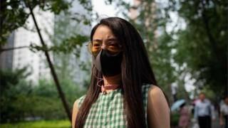 Woman with face mask in Beijing
