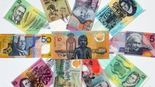 Australian dollar paper and polymer notes form a colourful mosaic