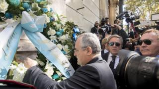Lazio Chairman Claudio Lotito puts a flower wreath at the synagogue in Rome