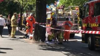 Emergency workers near the Melbourne consulates of India and France