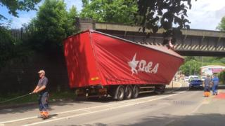 A picture of a lorry wedged under one of the bridges in June 2016