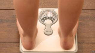 Young person on scales