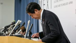 Japan's Education and Sports Minister Hakubun Shimomura bows after ending a news conference at his ministry