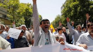 Iranian Islamists shout slogans during a protest against allowing women to sporting stadiums