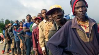 People queuing for food handouts in Zimbabwe