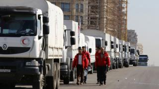 A Syrian Arab Red Crescent convoy prepares to leave Damascus to the besieged areas of Madaya and Zabadani, on 17 February 2016