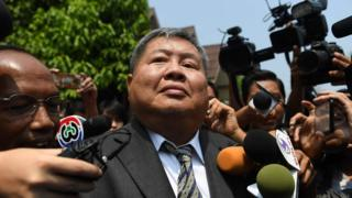 Premchai Karnasuta leaves the court after hearing the verdict against himself and three other suspects in a poaching case