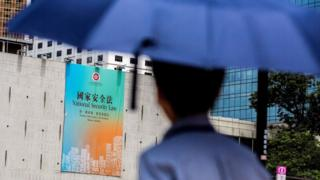 This file photo taken on 29 June 2020 shows a government advertisement promoting China's planned national security law, displayed on the city hall building in Hong Kong