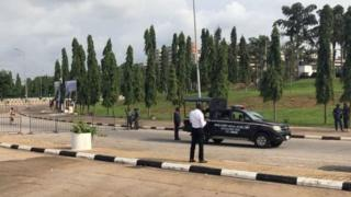 Members of di security forces close di area outside di National Assembly for Abuja