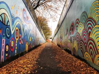Underpass street art and autumn leaves on Marston Ferry Road