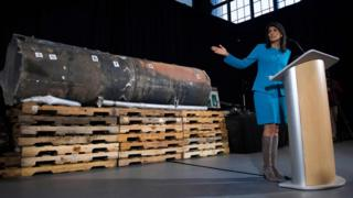 Nikki Haley gestures towards the remnants of a ballistic missile that came close to hitting Riyadh's airport in November, at Joint Base Anacostia in Washington on 14 December 2017