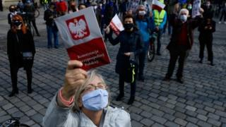 People wearing masks at a rally in Wroclaw, Poland, calling for the postponement of the presidential election. Photo: 3 May 2020