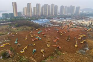 This aerial photo shows excavators at the construction site of a new hospital being built to treat patients from a deadly virus outbreak in Wuhan in China's central Hubei province.