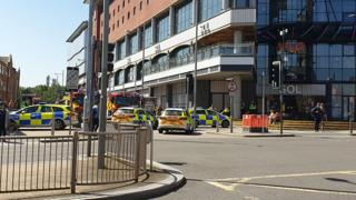 Several Police cars and fire engines in Northampton town centre.
