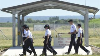 Young people of the SNU (Service National Universel) walk on the Luxeuil-Saint Sauveur air-base 116 in Saint-Sauveur, eastern France, on June 24, 2019