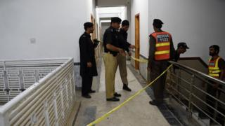 Pakistani police officials inspect a hostel at Abdul Wali Khan university where students beat to death a classmate in Mardan on April 13, 2017.
