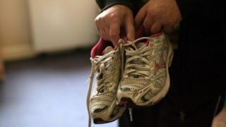 Man with trainers who was forced into labour