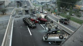 Overturned cars under a collapsed road bridge during the 2010 earthquake in Chile, Magnitude 8.8