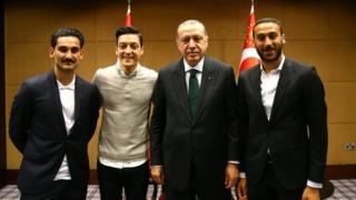 lkay Gundogan and Mesut Ozil, along with Everton's Cenk Tosun, pose with the Turkish president