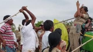 A still from the viral video in which a mob of men are seen attacking a woman forest officer