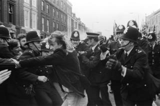 A left wing demonstrator called Robert Johnson tries to break through a police cordon