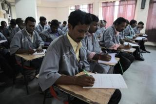 Unqualified medics receiving training in a classroom