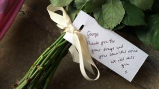 """George, thank you for your songs and your beautiful voice. We will miss you"": A tribute outside George Michael's home"