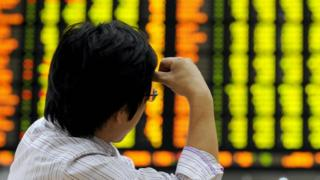 A man looks at stock market board in South Korea