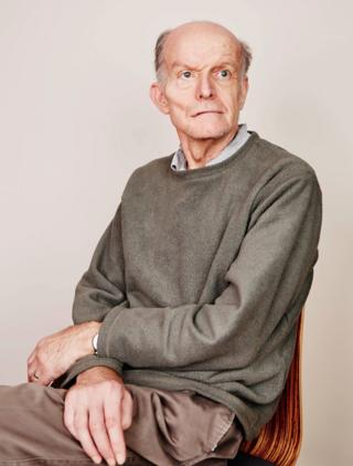 An elderly man sitting on a chair