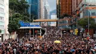 Protesters march through Kowloon