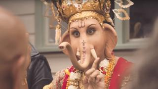 A still from a lamb advert depicting the Hindu god Ganesha