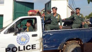 Cambodian police in the back of a pick-up truck