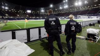Two police officers at the stadium in Hannover, Germany, on 18 November 2015