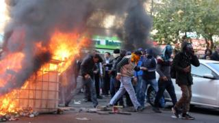 Kurdish protestors clash with Turkish police as they protest against the Turkish government in Diyarbakir,